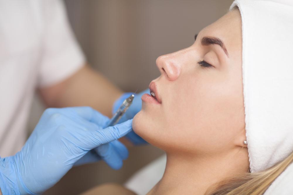Customer receiving dermal filler treatment in a beauty salon
